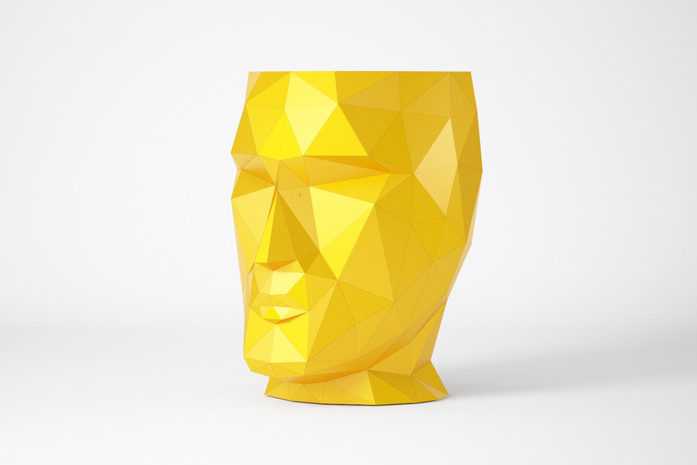 Support en forme de tête géométrique